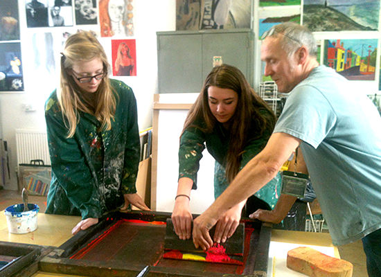 Truro School student at the Truro Combined Art workshop with visiting artist Tony Minnion and a student from another school