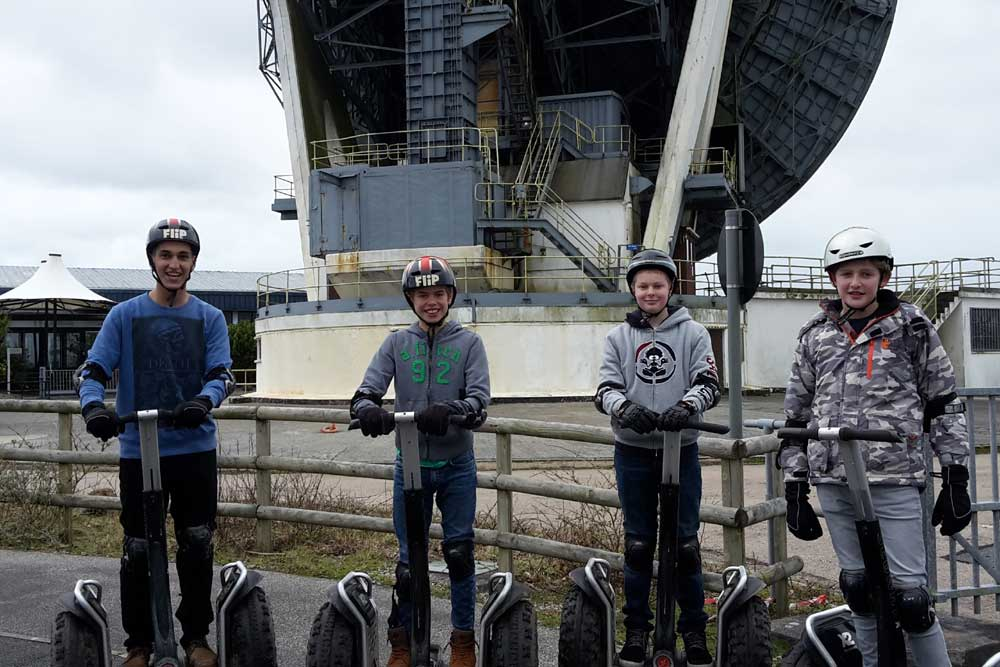 junior-boys-boarding-segway